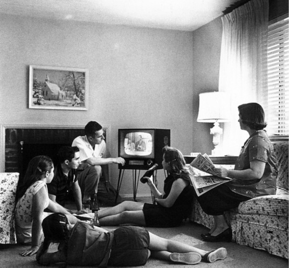 A family huddles around the television in the late 1950s.  (National Archives and Records Administration/Evert F. Baumgardner [Public domain], via Wikimedia Commons)