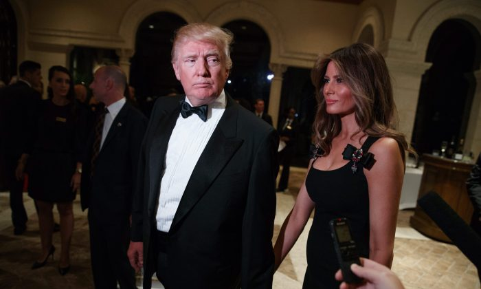 President-elect Donald Trump and his wife Melania arrive for a New Year's Eve party at Mar-a-Lago in Palm Beach, Florida, on Dec. 31. (AP Photo/Evan Vucci)