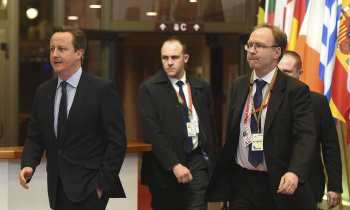 British Prime Minister David Cameron, left, and Britain's permanent representative to European Union Ivan Rogers, right, leave after an EU summit in Brussels on Feb. 19, 2016.  The British Foreign Office announced on Jan. 3, 2017, that Rogers has resigned, without giving any details about his departure. (AP Photo/Geert Vanden Wijngaert, FILE)