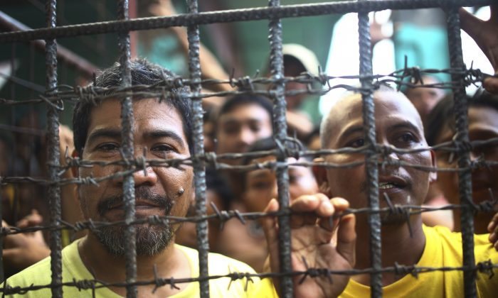 Filipino inmates remain in their cell at the North Cotabato District Jail after a massive jailbreak in Kidapawan city, Cotabato Province, southern Philippines,  on Jan. 4, 2017. (AP Photo)