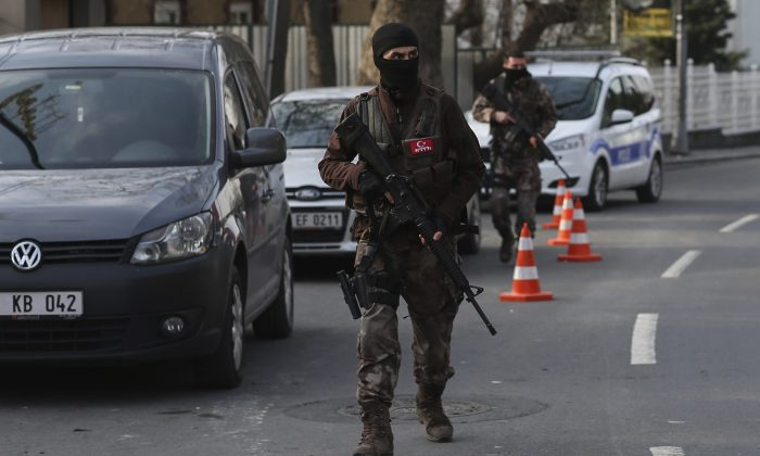 Turkish special security force members patrol near the scene of the Reina night club following the New Year's day attack, in Istanbul on Jan. 4, 2017. (AP Photo/Emrah Gurel)