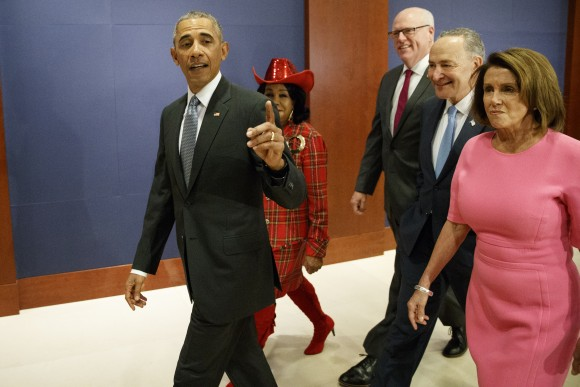 President Barack Obama, joined by, from second from left, Rep. Frederica Wilson, D-Fla., Rep. Joseph Crowley, D-N.Y., Senate Minority Leader Charles Schumer of N.Y., and House Minority Leader Nancy Pelosi of Calif. arrives on Capitol Hill in Washington on Jan. 4, 2017, to meet with members of Congress to discuss his signature healthcare law. (AP Photo/Evan Vucci)