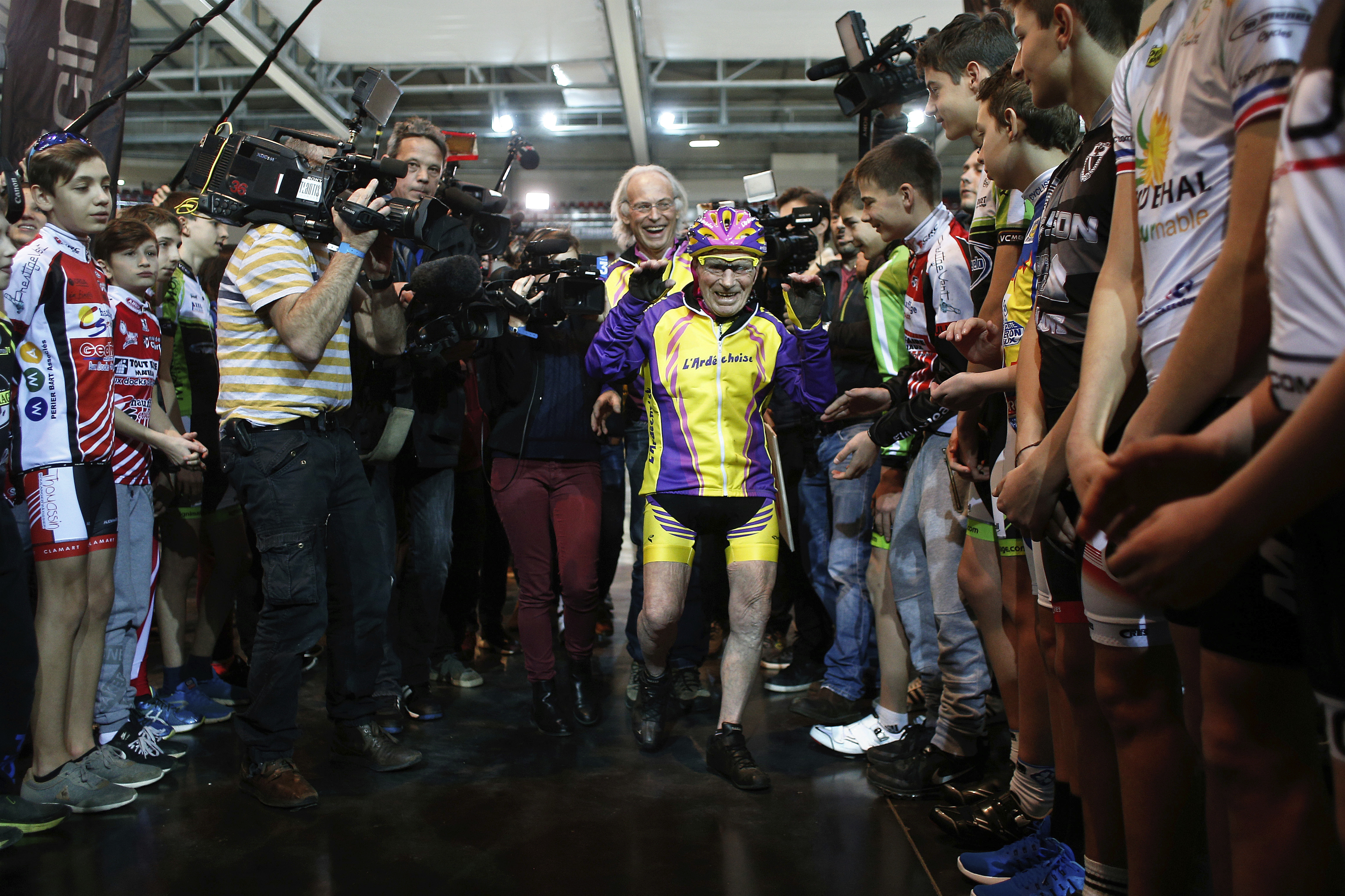 French cyclist Robert Marchand, aged 105, arrives prior to cycle in a bid to beat his record for distance cycled in one hour, at the velodrome of Saint-Quentin en Yvelines, outside Paris on Jan. 4, 2017. (AP Photo/Thibault Camus)