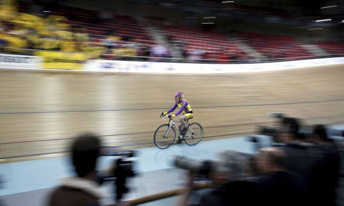 French cyclist Robert Marchand, 105, cycles in a bid to beat his record for distance cycled in one hour, at the velodrome of Saint-Quentin en Yvelines, outside Paris on Jan. 4, 2017. (AP Photo/Thibault Camus)