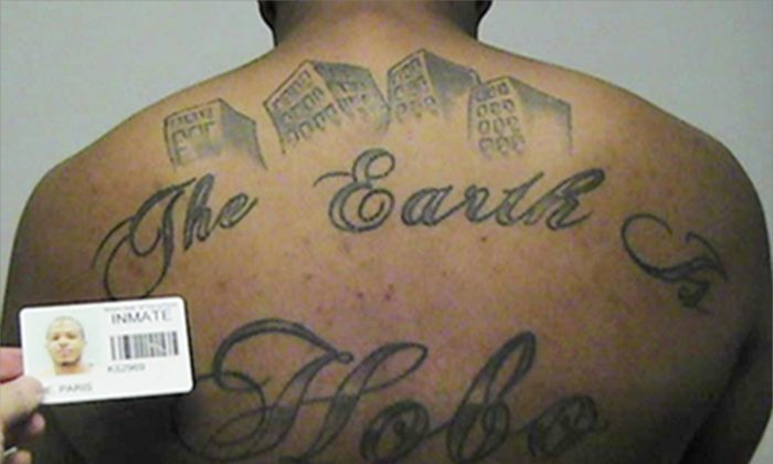 """This undated file photo in a court filing provided by the United States Attorney's office in Chicago, shows Paris Poe's back tattoo that reads """"The Earth Is Our Turf"""", and Hobo. (United States Attorney's office in Chicago via AP file)"""