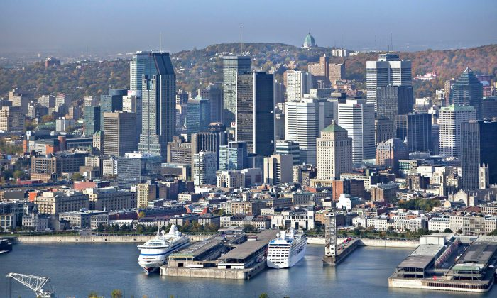 Montreal skyline and the St. Lawrence River. The city is celebrating its 375th anniversary with a plethora of events throughout the year. (Tourisme Montréal, Stéphan Poulin)
