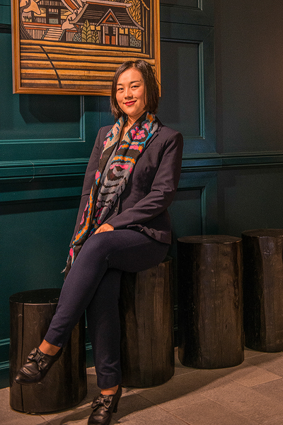As a young professional working as an accountant for a high-end boutique hotel chain, Gu is on top of her world with a new life in the United States and awaiting a reunion with her parents. (Cat Rooney/Epoch Times)
