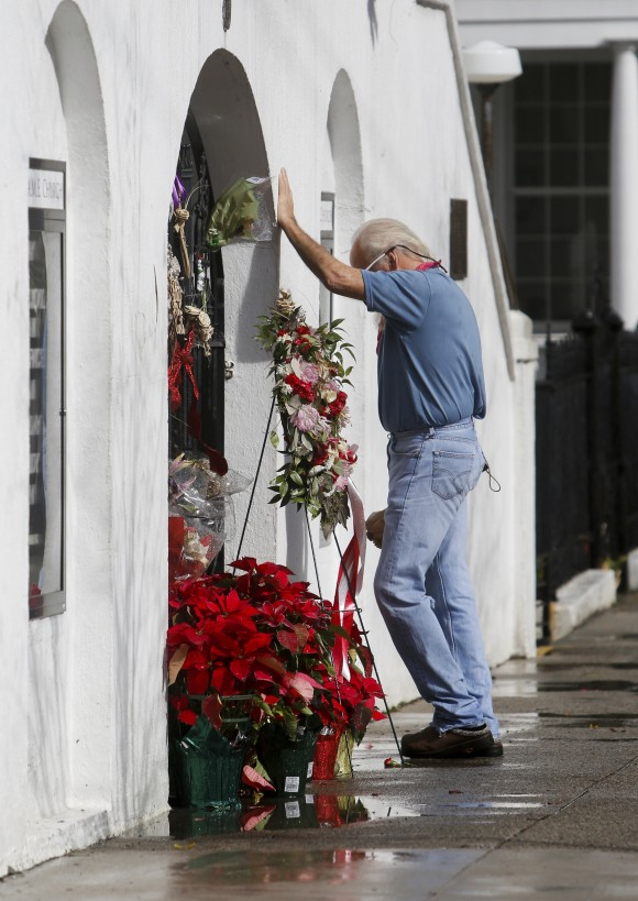 John Johnson pays his respects at the Emanuel African Methodist Episcopal Church in Charleston, S.C., on Jan. 3, 2017. (Michael Pronzato/The Post And Courier via AP)