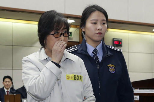 Choi Soon-sil, left, the jailed confidante of impeached South Korean President Park Geun-hye, appears for her trial at the Seoul Central District Court in Seoul, Thursday, on 5, 2017. (Chung Sung-Jun/Pool Photo via AP)
