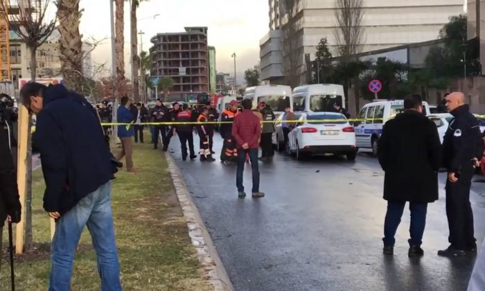 Emergency services stand at the scene of an explosion, in Izmir, Turkey on  Jan. 5, 2017. (AP)