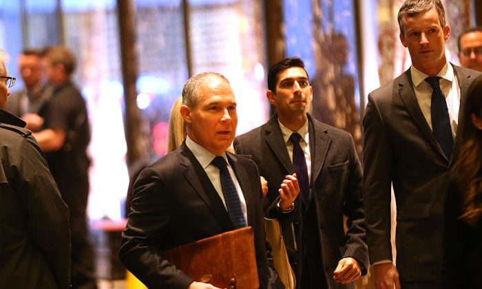 Oklahoma Attorney General Scott Pruitt (L) arrives at Trump Tower on Dec. 7, 2016 in New York City. Potential members of President-elect Donald Trump's cabinet have been meeting with him and his transition team. (Spencer Platt/Getty Images)