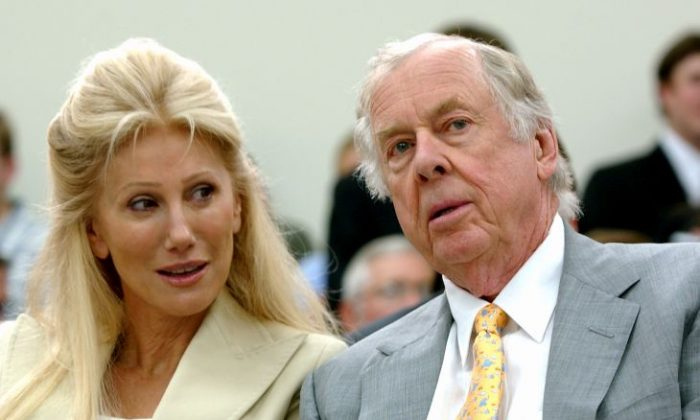 In this July 25, 2006, file photo, Oklahoma energy tycoon T. Boone Pickens, right, with his wife, Madeleine, appear at a House Energy and Commerce subcommittee hearing on Capitol Hill in Washington. A federal lawsuit accuses Madeleine Pickens, the ex-wife Pickens, of racial discrimination at her rural Nevada dude ranch. (AP Photo/Dennis Cook, File)