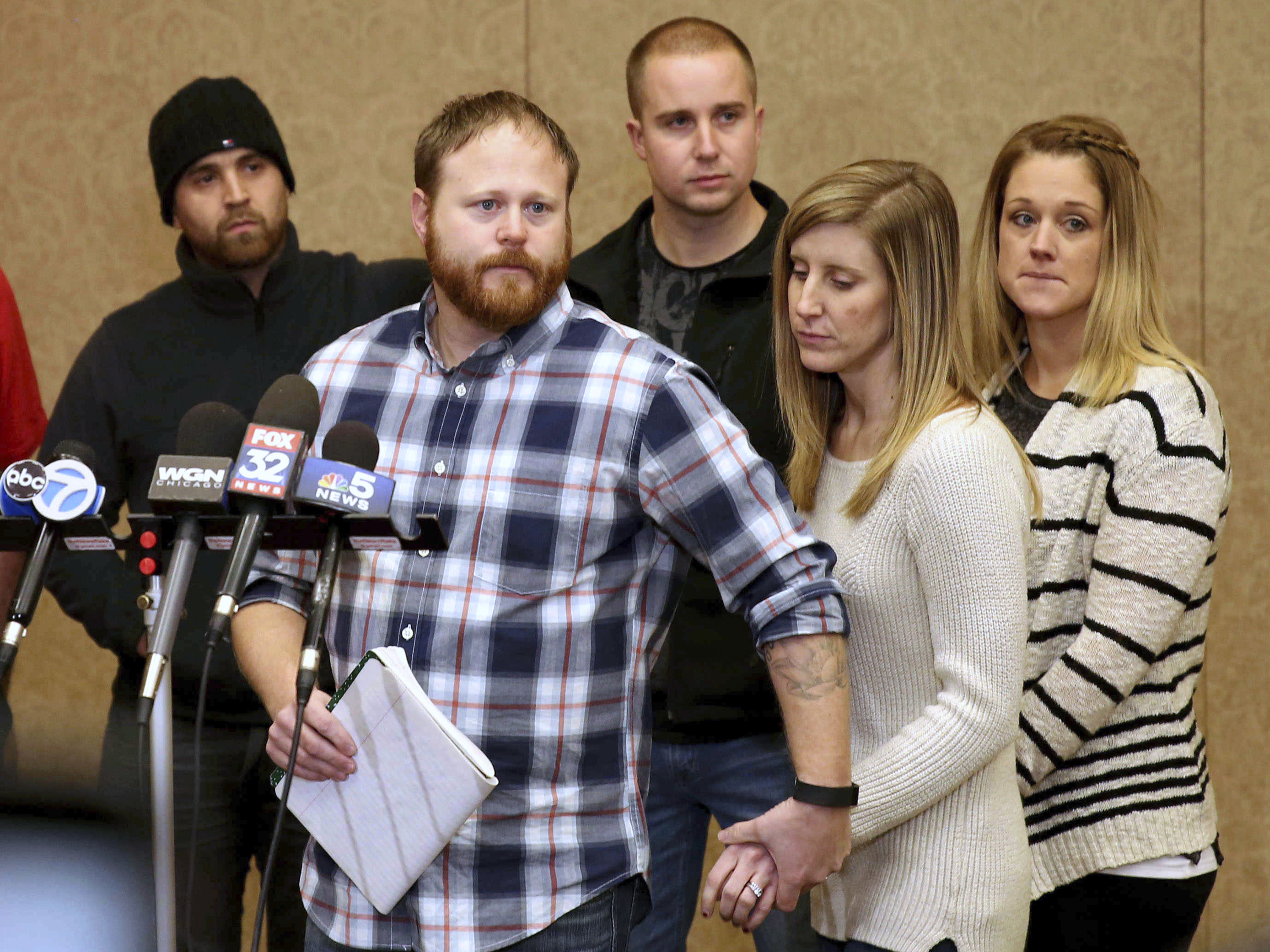 Family spokesman David Boyd and others hold a news conference on Jan. 5, 2017. (Patrick Kunzer/Daily Herald via AP)