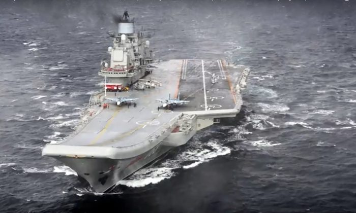 In this file photo, the Admiral Kuznetsov aircraft carrier during its mission in the eastern Mediterranean Sea. (Russian Defense Ministry Press Service/ Photo via AP)