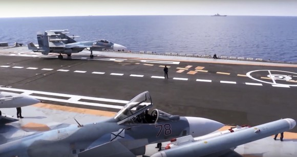 In this file photo, Russian Su-33 fighter jets stand on the flight deck of the Admiral Kuznetsov aircraft carrier in the eastern Mediterranean Sea (Russian Defense Ministry Press Service/ Photo via AP)