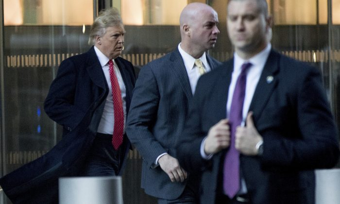 President-elect Donald Trump, left, departs a meeting at the Condé Nast offices at One World Trade Center in New York on Jan. 6, 2017. (AP Photo/Andrew Harnik)