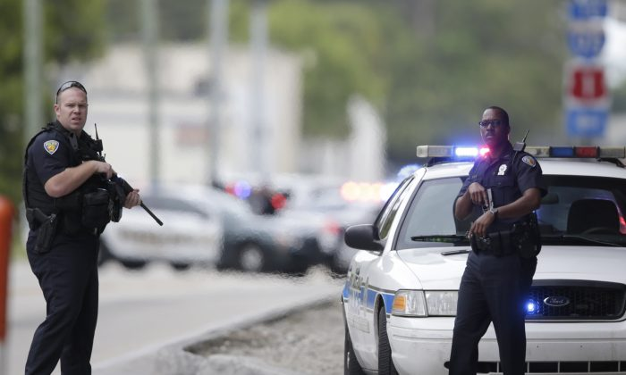 Police officers stand on a road along the Fort Lauderdale-Hollywood International Airport in Florida in this file photo taken on Jan. 6, 2017. (Lynne Sladky/AP Photo)