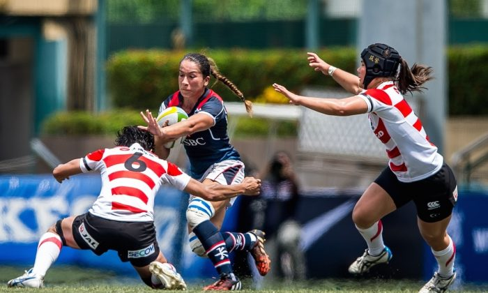 Rose Fong of Hong Kong attacks in their Asia Championship match against Japan in Hong Kong on May 6, 2016. (Ike Li/Ikeimages)