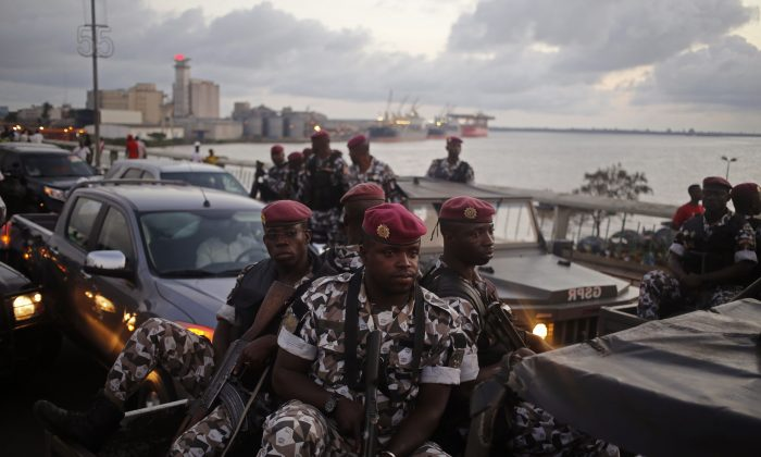 In this file photo taken Friday, Oct. 23, 2015, Ivory Coast troops provide security during an election rally of Ivory Coast incumbent President Alassane Ouattara in Abidjan, Ivory Coast. (AP Photo/Schalk van Zuydam, File)