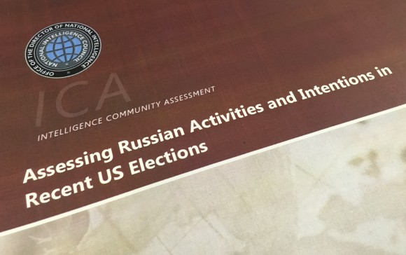 A part of the declassified version Intelligence Community Assessment on Russia's efforts to interfere with the U.S. political process in Washington on Jan. 6, 2017. (AP Photo/Jon Elswick)