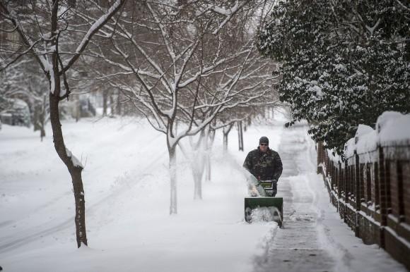 Daniel Mitchell operates a snowblower along the sidewalk on Norfolk Ave. next to Randolph College in Lynchburg, Va. on Jan. 7, 2017. (Jay Westcott  /News & Daily Advance via AP)