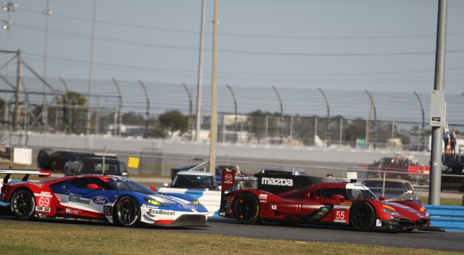 Mazda brought both its new Mazda RT24-P DPis to the Roar, the #55 resplendent in red while the #70 was cloaked in titanium silver. While beautiful, both cars lost time to electrical and mechanical issues. (Chris Jasurek/Epoch Times)