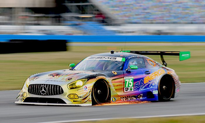 The #75 Continental SunEngery1 Mercedes AMG GT3 sheds sparks as it brakes entering the West Horseshoe. (Bill Kent/Epoch Times)
