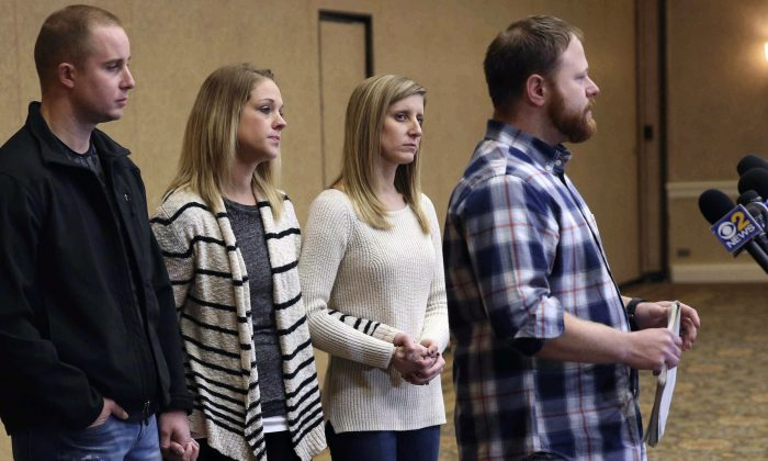 Family spokesman David Boyd (R) and others hold a news conference in Crystal Lake, Ill., on Jan. 5, 2017. (Patrick Kunzer/Daily Herald via AP)