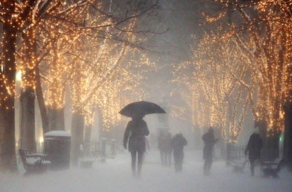 People walk through the Commonwealth Avenue Mall during a winter storm in Boston on Jan. 7, 2017. A storm that wreaked havoc along the East Coast arrived in southern New England on Saturday, bringing blizzard conditions to some areas and making travel treacherous throughout the region. (AP Photo/Michael Dwyer)