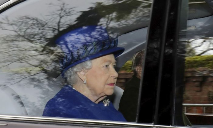 Britain's Queen Elizabeth II in a car with Prince Philip, arrives to attend the morning church service at St Mary Magdalene Church in Sandringham, England, Sunday Jan. 8, 2017.  The 90-year-old British monarch was applauded by well-wishers as she arrived by car at St. Mary Magdalene Church in eastern England. It was her first public appearance in several weeks. (Chris Radburn/PA via AP)