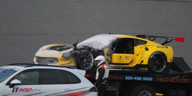 The damaged #4 Corvette Racing 7.R is hauled away after catching fire. (Chris Jasurek/Epoch Times)