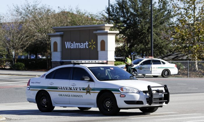 Orange County Sheriff's officers block the entrance to a Walmart near the scene where a police officer was shot in Orlando, Fla., Jan. 9, 2017. (AP Photo/John Raoux)