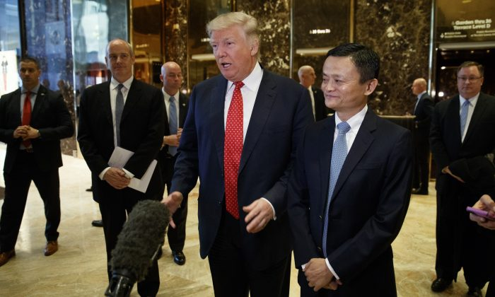 President-elect Donald Trump stands with Alibaba Executive Chairman Jack Ma as he speaks with reporters after a meeting at Trump Tower in New York on Jan. 9, 2017. (AP Photo/Evan Vucci)
