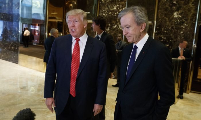 President-elect Donald Trump, accompanied by French businessman Bernard Arnault, speaks with reporters after meeting at Trump Tower in New York on Jan. 9, 2017. (AP Photo/Evan Vucci)