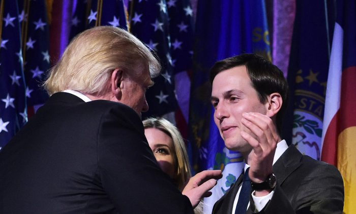 President-elect Donald Trump shakes hands with son-in-law Jared Kushner (R) during an election night party at a hotel in New York on Nov. 9, 2016. (MANDEL NGAN/AFP/Getty Images)