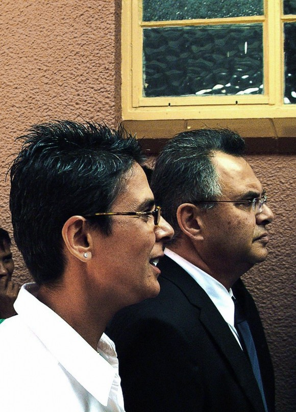 """Windhoek, NAMIBIA: US businesman Jacob """"Kobi"""" Alexander (R) and his wife Hana (L) at Windhoek magistrate's court for the extradition cause against him on April 25 2007. (BRIGITTE WEIDLICH/AFP/Getty Images)"""