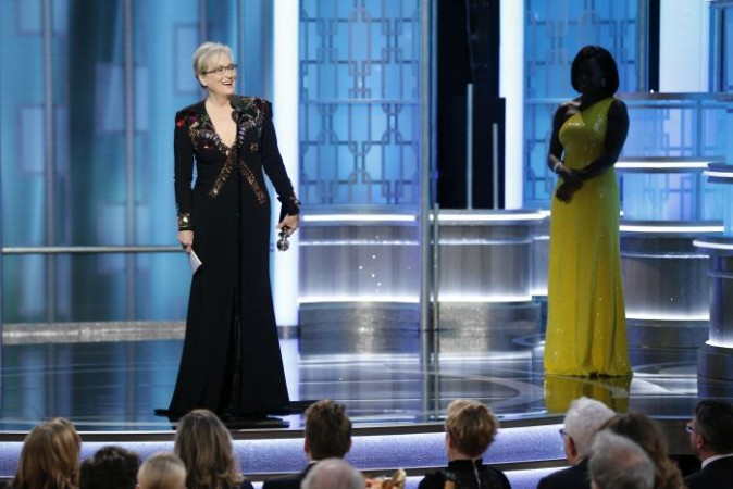 This image released by NBC shows Meryl Streep accepting the Cecil B. DeMille Award as presenter Viola Davis, right, looks on, at the 74th Annual Golden Globe Awards at the Beverly Hilton Hotel in Beverly Hills, Calif., on Sunday, Jan. 8, 2017. (Paul Drinkwater/NBC via AP)