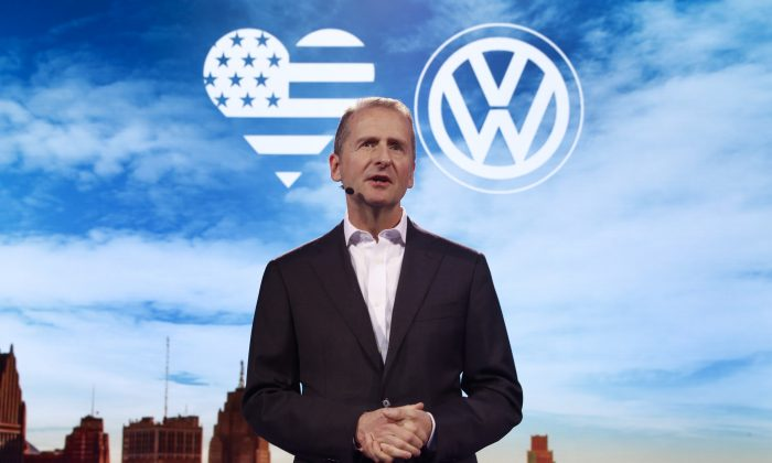 Herbert Diess, Member of the Board of Management of Volkswagen AG, Chairman of the Board of Management of the Volkswagen Passenger Cars brand speaks before the North American International Auto Show in Detroit on Jan. 8, 2017. (AP Photo/Paul Sancya)
