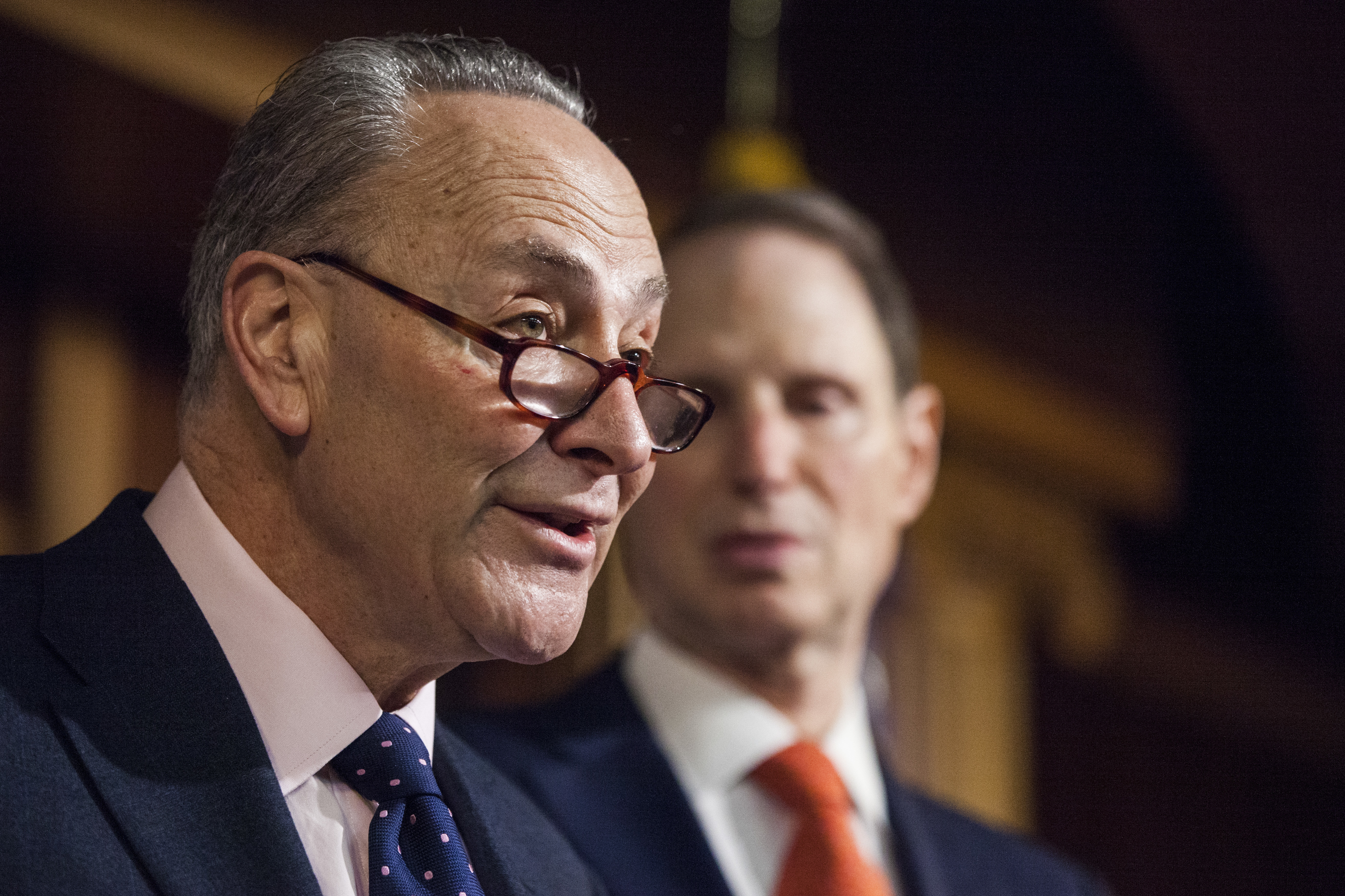 Senate Minority Leader Charles Schumer of N.Y. (L) accompanied by Sen. Ron Wyden, D-Ore., during a news conference on Capitol Hill in Washington on Jan. 5, 2017. (AP Photo/Zach Gibson)