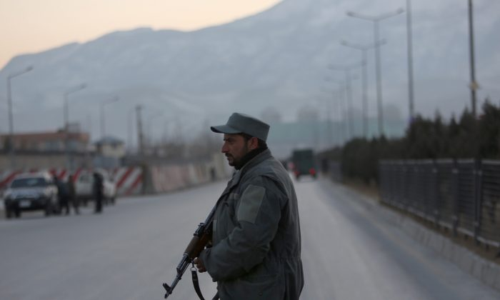 A member of the Afghan security forces stands guard near the site of two blasts in Kabul, Afghanistan on Jan. 10, 2017. (AP Photo/Rahmat Gul)