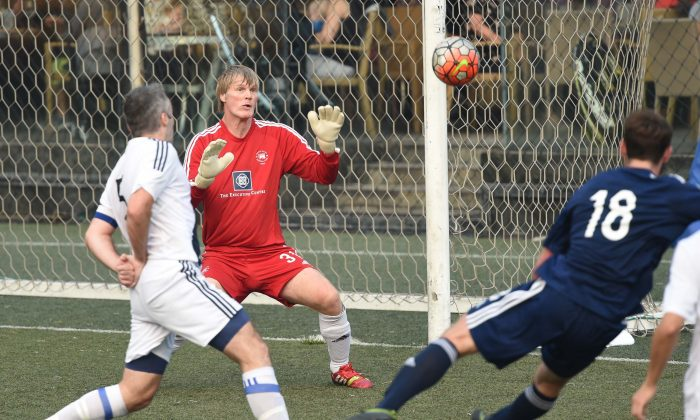Albion goalie, Rudy Hollaender carefully watches this ball goal attempt by Wanderers in the Derby match at Sports Road on Sunday Jan 8, 2017. (Bill Cox/Epoch Times)