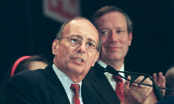 NEW YORK, UNITED STATES:  Incumbent Republican US Sen. Alphonse D'Amato(L) concedes defeat to Democratic challenger Charles Schumer in the New York senatorial race 03 November in New York. New York Republican Gov. George Pataki(R) was re-elected as governor of the State of New York. (STAN HONDA/AFP/Getty Images)