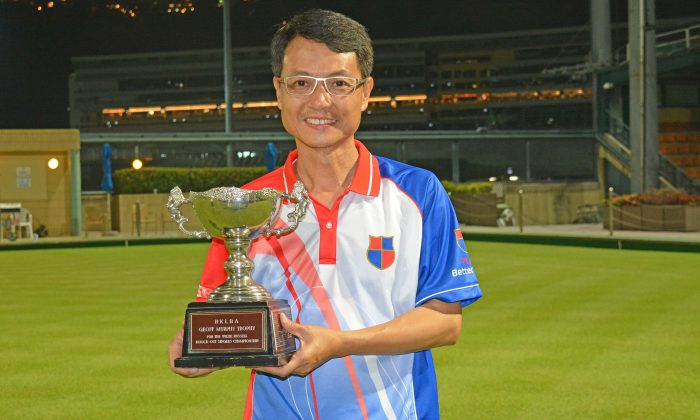 Raymond Ho from Kowloon Bowling Green Club proudly showing off his National Knock-out Singles trophy after defeating Craigengower Cricket Club's Robin Chok on Sunday night (Jan 8, 2017) at Hong Kong Football Club. (Stephanie Worth)