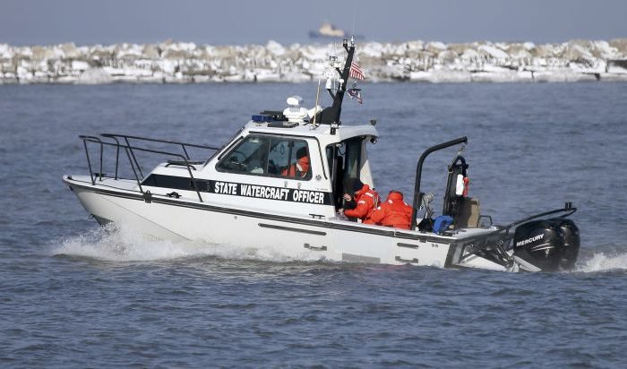 An Ohio Department of Natural Resources boat heads out to Lake Erie to help in the recovery operation of a missing plane, Friday, Jan. 6, 2017 near Cleveland. Crews searching Lake Erie on Friday found what may be human remains on a seat from a plane that was carrying six people when it disappeared more than a week ago. (Marvin Fong/The Plain Dealer via AP)