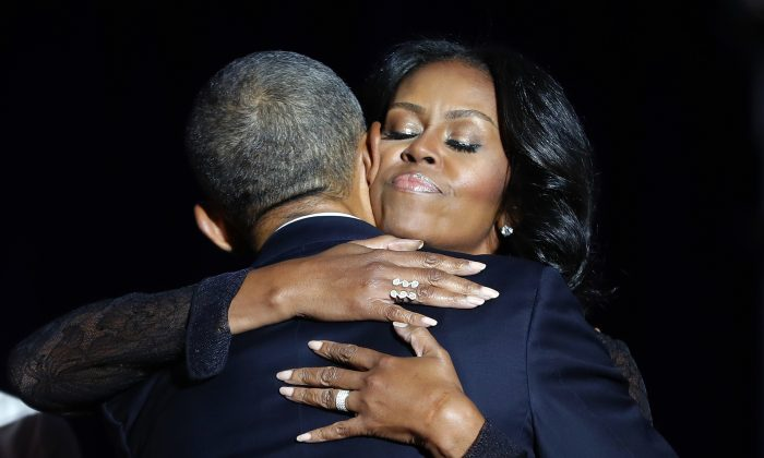 First lady Michelle Obama hugs President Barack Obama after his farewell address at McCormick Place in Chicago, Tuesday, Jan. 10, 2017. (AP Photo/Pablo Martinez Monsivais)