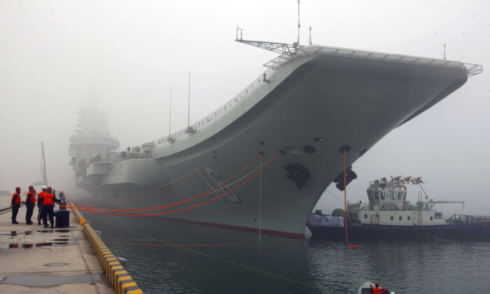 Chinese regime's first aircraft carrier, the Liaoning, is anchored in the northern port in Qingdao, east China's Shandong Province, on Feb. 27, 2013. (Wu Dengfeng/file/Xinhua via AP)