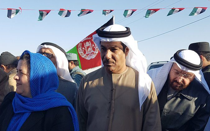 UAE Ambassador Juma Mohammed Abdullah al-Kaab, center, stands next to Nasrin Oryakhil, left, Afghanistan's minister of Labor, Social Affairs, Martyrs and Disabled, during an official ceremony of the Foundation for Khalifa bin Zayed Al Nahyan orphanage in Kandahar, Afghanistan on Jan 11, 2017. (UAE Embassy in Kabul via AP)