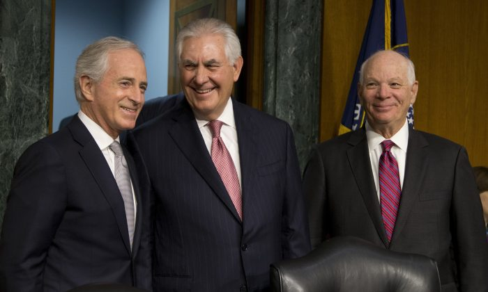 Senate Foreign Relations Committee Chairman Sen. Bob Corker, R-Tenn. (R) and the committee's ranking member, Sen. Ben Cardin, D-Md., stand with Secretary of State-designate Rex Tillerson on Capitol Hill in Washington on Jan. 11, 2017. (AP Photo/Steve Helber)