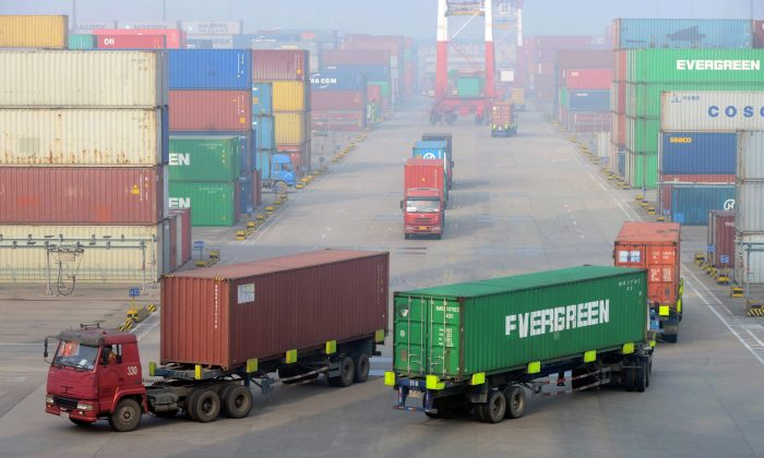 Cargo trucks drive through a container pool at a seaport in Qingdao in easternChina's Shandong province in this file photo. Canada aims to do more business with China amid a rising wave of protectionism. (Chinatopix via AP)