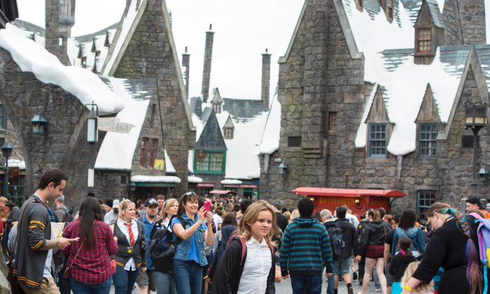 Fans discover Hogsmeade at the Grand Opening of the 'Wizarding World of Harry Potter' to the public at Universal Studios Hollywood, in Universal City, Calif. on Apr. 7, 2016. (VALERIE MACON/AFP/Getty Images)